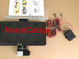 $enCountryForm.capitalKeyWord NZ - Remote Controlled Electric Retractable License Plate Frame Bracket Hide Away Kit