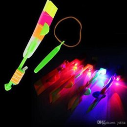 glowing helicopter toy NZ - LED Light Arrow Rocket Helicopter Rotating Flying Toy Kids Outdoor Night Flashing Toys Glow Party Supplies