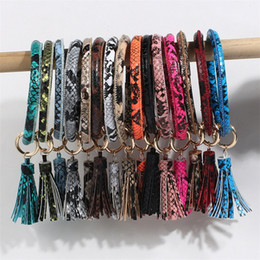 New boys bracelet online shopping - New Products Charm Keychain Bracelet Pu Leather Alloy Leopard Prints Tassel Keyring Bangle Women Key Holder Wrap Wristbands wx E1