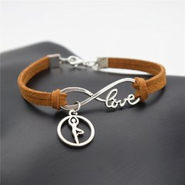 ballet charm bracelet Canada - Simple Style Brown Braided Leather Suede Rope Bracelets Men Women Infinity Love Ballet Gymnastics Posture Chakra Yoga Pendants Charm Jewelry