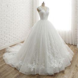 $enCountryForm.capitalKeyWord Australia - 2019 Modern White Wedding Dresses Back Lace Princess Ball Gown Custom Tulle Skirt Bridal Dress Court Train Appliques Lace Up Wedding Gowns
