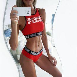 Vente en gros Femmes Respirant Shuffproof Rembourré Lettres Motif Midriff-Baring Débardeurs T-shirts Seamless Fitness Crop Tops Gilet 2018 Y190123