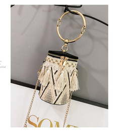wind straw NZ - Chain National Wind Ring Shoulder Bag Straw Woven Cylinder Small Bag Small Fairy Tassel Bucket Bag Best Selling