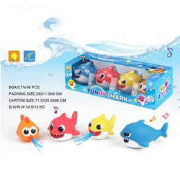 $enCountryForm.capitalKeyWord Australia - Wholesale 4pcs Baby Shark Plastic Toys With Music Lights Bath Toy Can Spray Water Kids Summer Outdoor Swimming Beach Pool Play Birthday Gift