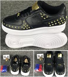 StarS leather online shopping - New arrival men s women s Rivet Star Skateboarding sports shoes Couple black white skate leather classics sneaker size EUR36 Plate Shoes
