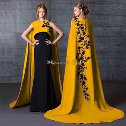 $enCountryForm.capitalKeyWord NZ - 2019 Gorgeous Saudi Arabia Long Evening Dresses with Cape Cap Sleeves Black Appliques Mermaid Satin Prom Gowns Gold Celebrity Formal Dress