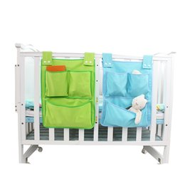 China Toy Diapers Crib Organizer Baby Cot Bed Hanging Bag Storage Bedding Set Multi-functional Bedding Accessories supplier green crib bedding sets suppliers