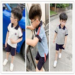 Kids Brand Clothes Sports Australia - Kids Designer Tracksuit Boys MON Brand Lapel Stripes T-shirt+Shorts 2 Piece Sets Short Sleeves Sports Clothing Sportswear By DHL New C52502