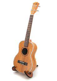 China free shipping 26 inch ukulele zebra wood ukulele small guitar beginner entry instrument suppliers