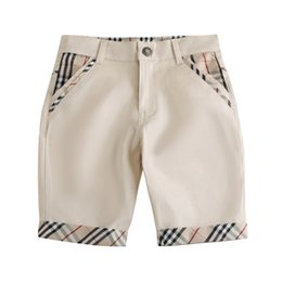 Vente en gros pantalons garçons 2019 INS NEW Fashion enfants été nouveaux styles à carreaux Pantalons coton de haute qualité de style de loisirs style garçons pantalon à cinq points livraison gratuite