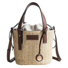 straw bag hand weaving Canada - Summer Beach Straw Woven Shoulder Bag Tote Simple Portable Bucket Small Hand Bags Fashion Outdoor Crossbody Messenger Bag Totes