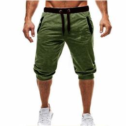 Mens Baggy Jogger Casual Slim Harem Shorts Doux 3/4 Pantalon Mode Nouvelle Marque avec Logo Hommes Pantalons De Survêtement D'été Confortable Homme Shorts M-3XL en Solde