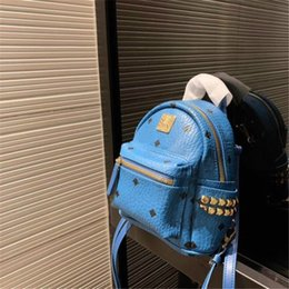womens mini backpacks Australia - Designer Backpack with Rivet Womens Backpack Mini Pattern Newest Arrival Size 18cm *21cm Pink Blue Hot Ladies Bags #o889