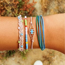 summer flower bracelet Canada - 4pcs Bracelet Set Bohemian Multi-Layer Braided Bracelet For Women Girls Wax String Seed Beads Summer Beach Jewelry
