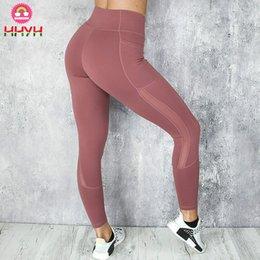 Venta al por mayor de Leggings de bolsillo Moda para mujer Push Up Fitness Leggings Mujeres Sexy Inserción de malla Leggings Pantalones de mujer Pantalones deportivos deportivos elásticos Jeggings