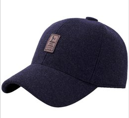 36a24b35d460f Men s hat Winter middle-aged and old woolen baseball cap Autumn and winter  leisure warm protection ear duck tongue cap Men s sun cap