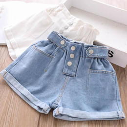 kids jeans designs Canada - 3T-10T Wholesale Children's denim shorts baby girls clothes Button design GIrls casual hot pants kids clothes jeans shorts L233
