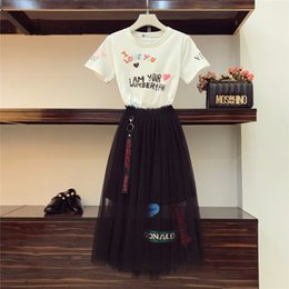 $enCountryForm.capitalKeyWord Australia - 2019 Summer Gauze Skirt Suits Women New Graffiti Printing T-shirt & Black Mesh Skirts Set Girl Students Two - Piece Suit J190716