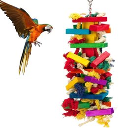 China Parrot Toys Cage Bird Articles Tuba Colour Bird Toys Cotton Rope Wood Gnaw Parrot Gnaw Toys suppliers