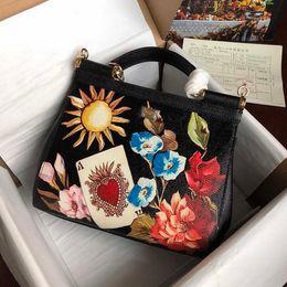 $enCountryForm.capitalKeyWord NZ - New designer luxury handbags fashion flowers printed black white cow leather Satchel bag top quality ladies brand bags Free Shipping
