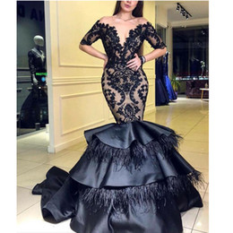 celebrities red carpet skirt UK - Modest Black Mermaid Feather Evening Dresses Sheer Neck Half Sleeve Appliques Sequined Celebrity Gown Tiered Skirt Evening Wear
