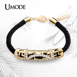 curved bar bracelet NZ - UMODE Hollow Curve Stylish Austrian Rhinestones Gold Color Rope Charm Bracelet Feminino Bangle Jewelry for Women UB0072