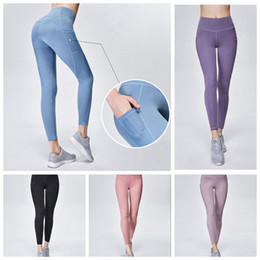 0d8673f9c78ea 2019 Women Yoga Pants with pocket Gym Sport Leggings Elastic Compression  Tights Fitness Women Night Running Sportwear Trousers 11 color