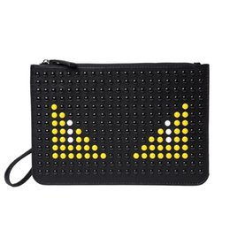 Pu bag material online shopping - Fashion personality little monsters pu material clutch bag new design monster printing bag leather clutch bag