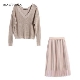 b70454db65 BIAORUINA Women's Sweet Solid Knitted Sweater V-neck + Office Lady Fashion  Pleated Mesh Skirt Two-pieces Set High Waist Sets