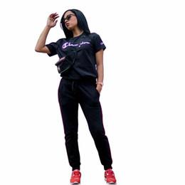 9f18114635de Women Summer Short Sleeve Tracksuit Champions Letter T-shirt + Pants 2  Piece Sets Outfits Joggers Sports Suits S-XL Sportswear Cloth C437