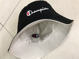 Foldable hats men online shopping - 2019 Unisex Champions Bucket Designer Men Women Hat Brand Double sided Embroidery Letters Cap Foldable Sunhat Outdoor Hats Colors C61301