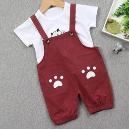 $enCountryForm.capitalKeyWord NZ - New Boys Clothes Set Summer Cartoon T-shirt + Small Feet Pattern Baby Boy Overalls Pants 2Pcs Clothes Boy Kids Clothing Set