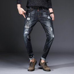 $enCountryForm.capitalKeyWord Australia - Brand new mens jeans designer retro jeans trend personality hole pants fashion stretch pants motorcycle riding pants cycling clothing jeans