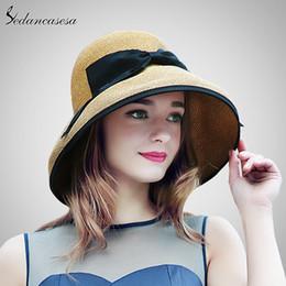 $enCountryForm.capitalKeyWord Australia - 2019 New Summer Wide Brim Beach Women Sun Straw Hat Elegant Cap For Women Uv Protection Black Bow Straw Hats Girls Hot Sw129001 Y19070503