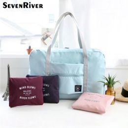 $enCountryForm.capitalKeyWord Canada - Cheap Foldable Waterproof Travel Storage Bag Multifunction Casual Tote Hangbag Bathroom Solid Zipper Bags For Women 2017