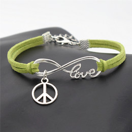 $enCountryForm.capitalKeyWord Australia - Fashion Infinity Love Peace Symbols Round Cross Pendant Jewelry Punk Green Braided Leather Suede Rope Bracelet for Men Women Wrist Band Gift