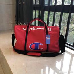 $enCountryForm.capitalKeyWord Australia - 2019 new brand fashion men women travel bag duffle bag, leather luggage handbags large capacity sport bag Black, red