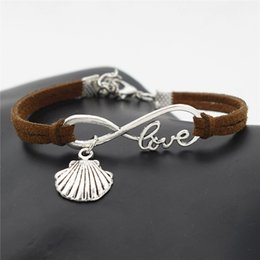 $enCountryForm.capitalKeyWord NZ - Handmade Dark Brown Leather Suede Wrap Bracelets & Bangles Silver Alloy Infinity Love Sea Shell Conch Seashell Women Men Charm Jewelry Gifts