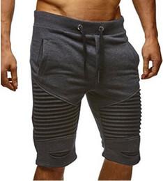 $enCountryForm.capitalKeyWord NZ - Summer Men Shorts Trousers Folds Hole Elastic Fashion Draped Designer Shorts Rope Belt Mens Pants Knee Length Clothing M-3XL Wholesale