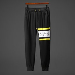 $enCountryForm.capitalKeyWord NZ - 2019 new hot sale men and women models spring and autumn cotton black striped letters stars print temperament couple pants