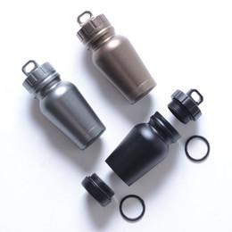 Aluminium tAnks online shopping - Outdoor EDC Mini Medicine Bottle Aluminium Alloy Waterproof Tank Sealed Empty Bottles Grey Black Champagne Color lb E1
