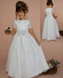 White Communion Dresses Short Australia - 2019 On Sale First Holy Communion Gowns Ivory Organza Short Sleeves Buttons Back Bow Sash Cheap Holy Communion Dresses For Sale
