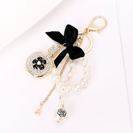 water bottles for boys NZ - Luxury Rhinestone Crystal Twinkling Perfume Bottle Keychain Black Bow Pearls Beads Charm Women Key Ring for Girls Handbag
