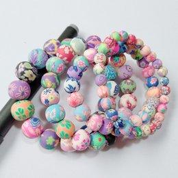 Hohe qualität 4 Größen 6/8/10 / 12mm Ball Soft Clay Stein Perlen Charme Armbänder Beste Geschenke Multicolor blumen Designer Ethnische Schmuck Armbänder