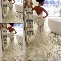 $enCountryForm.capitalKeyWord Australia - 2019 Lace Floral Long Train Mermaid Beach Wedding Dresses Sexy Backless Fishtail Train Beach Bridal Gowns With Big Bow Cheap