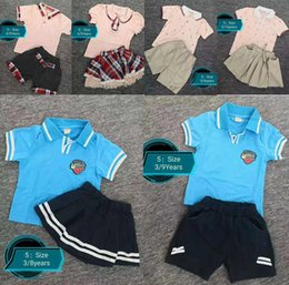 $enCountryForm.capitalKeyWord Australia - New Designer Kids Boys Girls Sportswear Children Short Sleeves Suit Kids Set Summer Clothes 1 lot=1set=2pieces Lapel sports suit