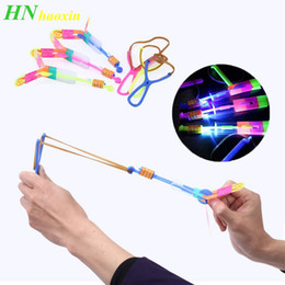 Helicopter slingsHot toys online shopping - HaoXin Led Light Toys for Children Flashing Luminous Slingshot Helicopter Rotating Flying Toys Kids Boys Outdoor Game Party Gift