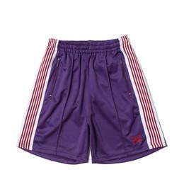 $enCountryForm.capitalKeyWord NZ - New Designer Summer Style Flash design Shorts Men women Needles butterfly shorts style god pant sport Pants