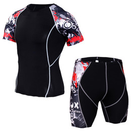 sport tight clothes Canada - Mma Compression Set Men Run Jogging Suits Sport Clothes Short Sleeve T Shirt And Shorts Sportswear Gym Fitness Workout Tights SH190829