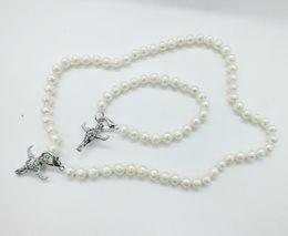 $enCountryForm.capitalKeyWord Australia - 1 set of fashion jewelry set. 8-9mm white freshwater pearl necklace. bracelet. HAVE many hollow cage pendant models, optional